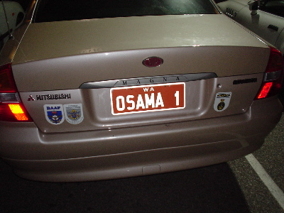 The license plate, stuck to a Mitsubishi Magna I saw in my neighborhood, says 'Osama 1'